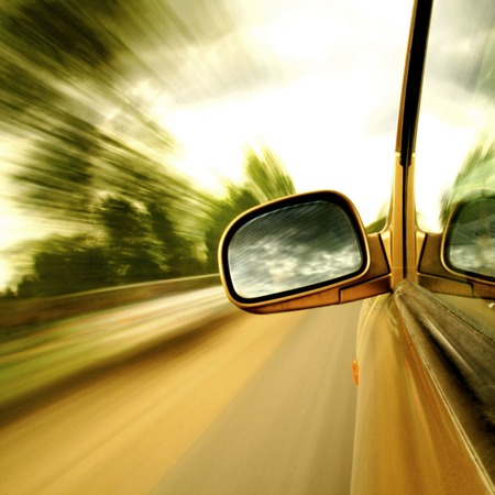 Side mirror view driving in forest road Stock Photo
