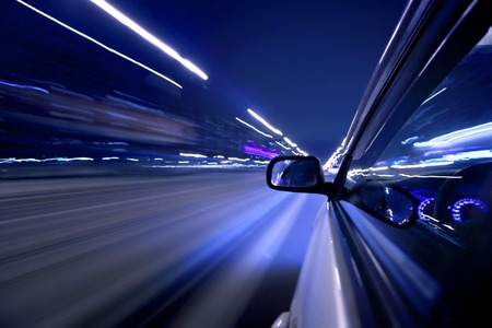 side light: Side view on moving fast car at night Stock Photo