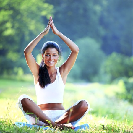 Young woman doing yoga exercise outdoor photo