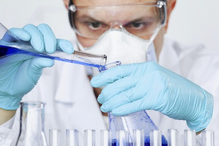 Male researcher carrying out scientific research in a lab photo