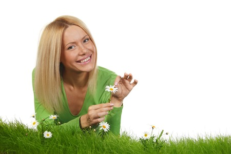 Beautiful woman laying on grass with flowers, isolated on white background photo