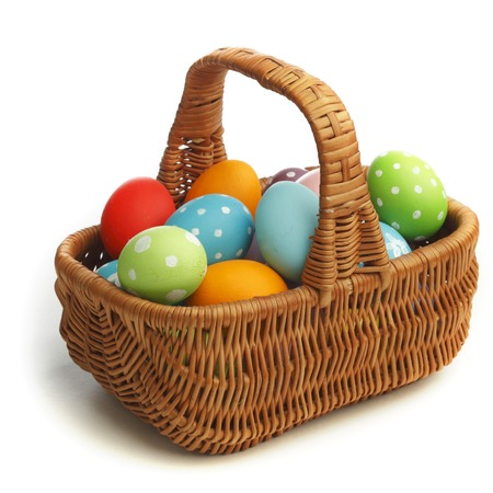 Basket with eater eggs isolated on white