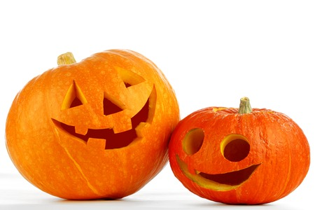 Two funny Jack O Lantern halloween pumpkins isolated on white background photo