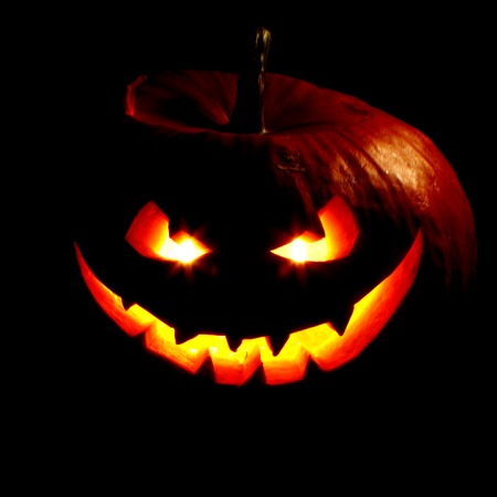 Scary smiling Halloween pumpkin on dark background