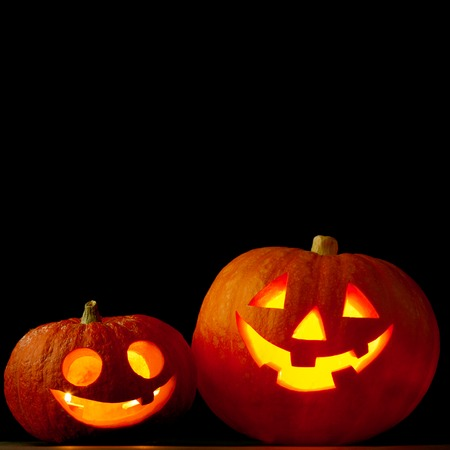 Halloween pumpkins isolated on black  photo