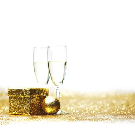 Champagne in glasses and gift box on golden  photo