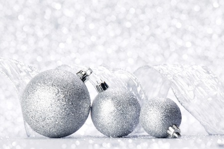 silver ribbon: Christmas decorative balls and ribbon on silver glitter background