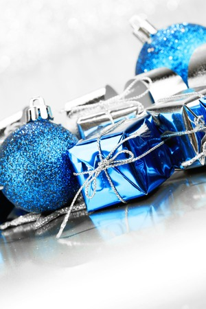 Christmas gifts and decoration on shiny glitter background photo