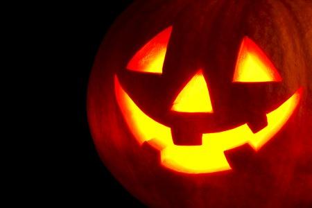 Halloween pumpkin isolated on black background photo