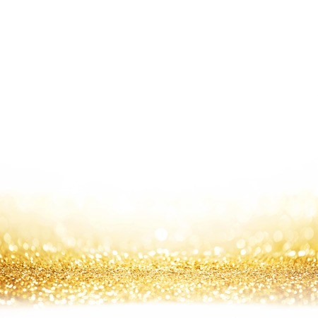 Golden festive glitter background with defocused lights Фото со стока