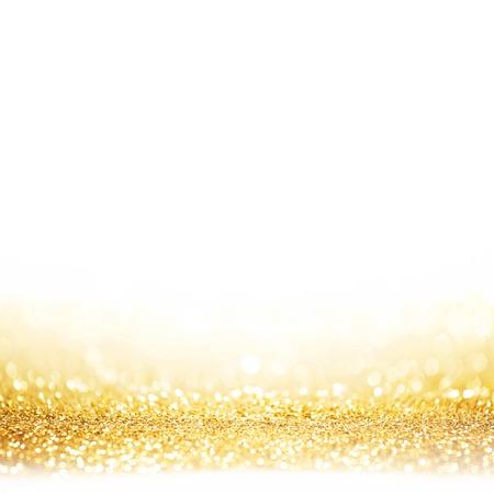Golden festive glitter background with defocused lights Archivio Fotografico