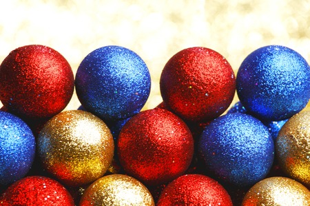 Pile of colorful Christmas balls with blurred background photo