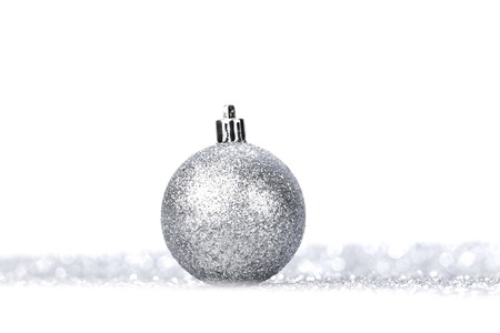 Beautiful Glitter christmas ball close-up on shining background photo