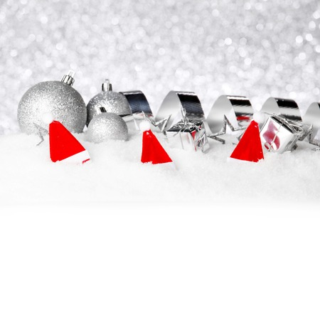 Silver Christmas decorations on snow close-up photo
