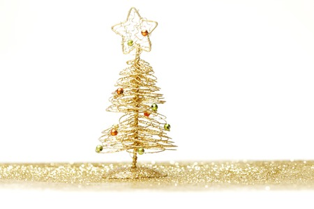 toygift: Toy small Christmas tree with decoration on white background