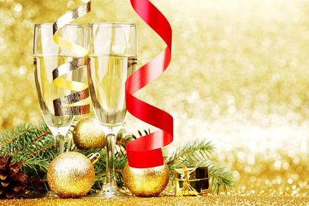 Glasses of champagne and decoration with natural fir branch photo