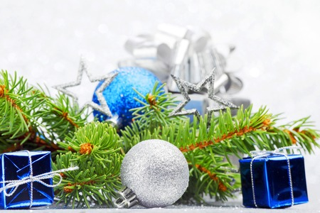Firtree and christmas decor on glitter silver background photo