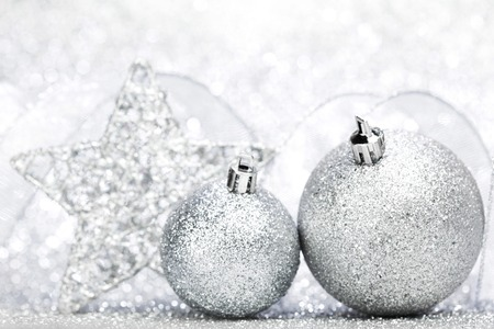 Christmas decoration on silver glitter background photo