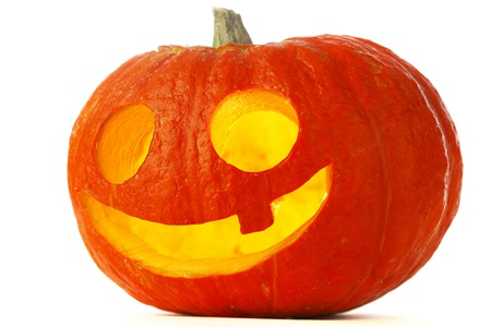 Funny Jack O Lantern halloween pumpkin with candle light inside isolated on white background photo