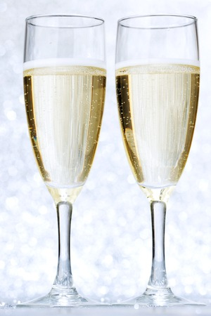 silver flute: Pair of champagne flutes on shiny glitter background