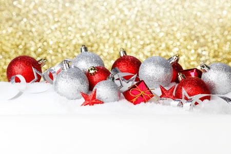Beautiful various christmas decor on snow close-up photo