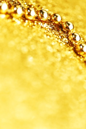 Gold christmas tree garland on glitter background close-up photo