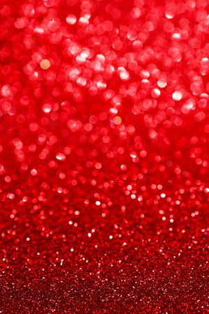 Abstract glitter bokeh holiday red background photo