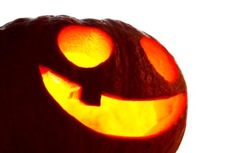 Jack O Lantern halloween pumpkin with candle light inside isolated on white background photo