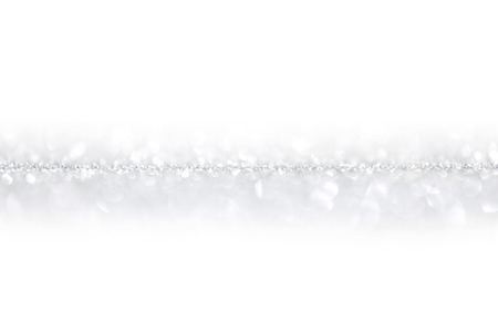 Shiny silver defocused glitter holiday background with white copy space photo