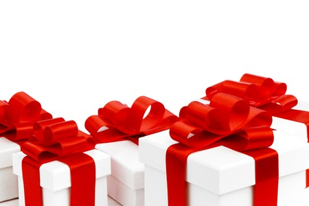 White gift boxes with red ribbons isolated on white background photo