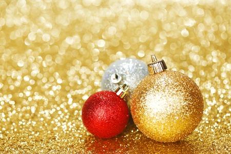 Colorful christmas balls on shining glitter background close-up photo