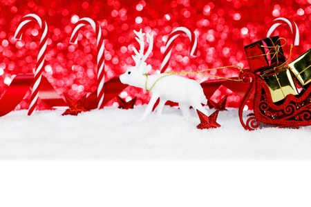 Beautiful colorful christmas decoration and candies in snow photo