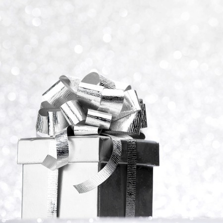 silver ribbon: Decorated holiday gift on silver background Stock Photo