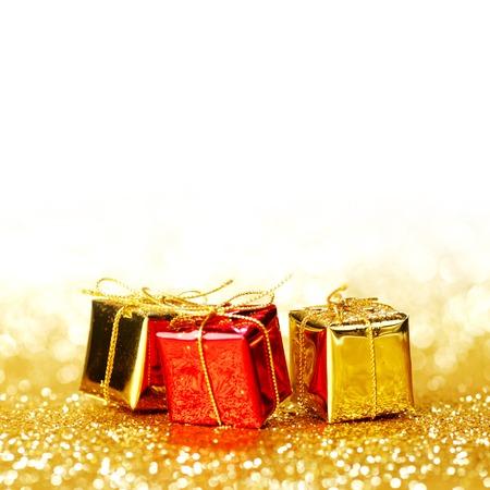 Decorative holiday gift boxes on bright shiny background photo
