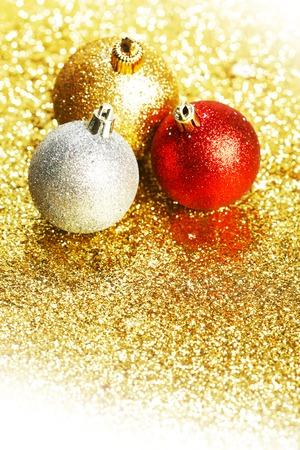 Beautiful Glitter christmas balls close-up on shining background photo