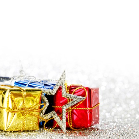 Decorated holiday gifts on silver background photo