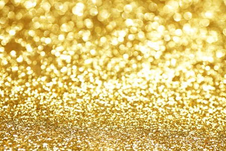 Abstract shining glitters gold holiday bokeh background Stockfoto