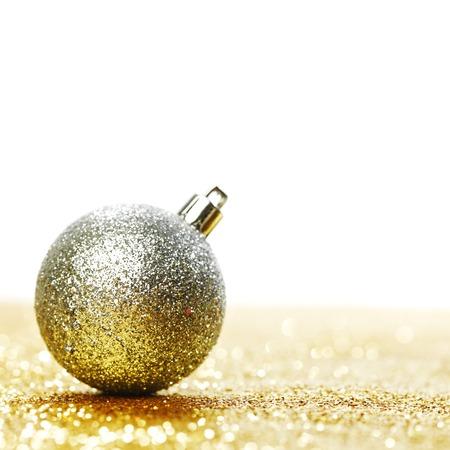Beautiful Glitter christmas ball close-up on shining background photo