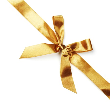 白で隔離される黄金サテン ギフト ボー リボン