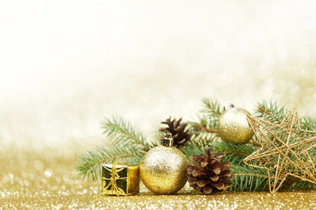 Christmas card with fir and decor on glitter background photo
