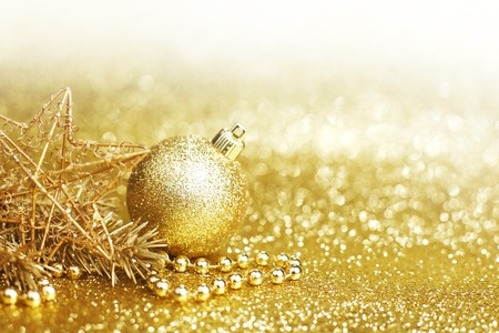 Golden christmas decor on glitter background with copy space photo