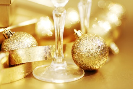 Glasses of champagne and golden decoration close-up photo