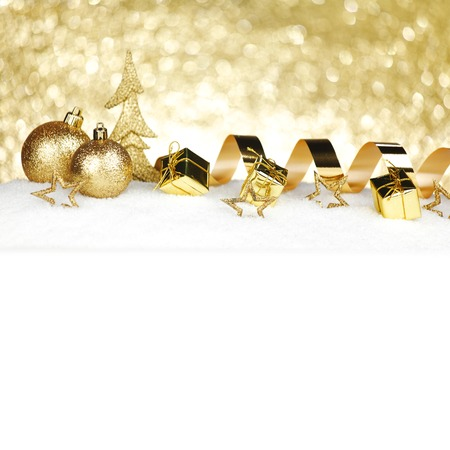 Christmas card with decorative golden baubles on snow photo