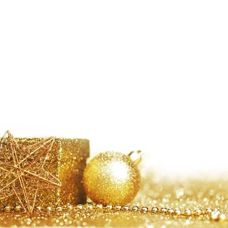 Golden beautiful christmas decor on glitter background photo