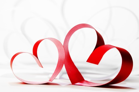 Red hearts of ribbon on white background photo