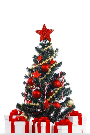 Decorated Christmas tree and presents isolated on white background photo