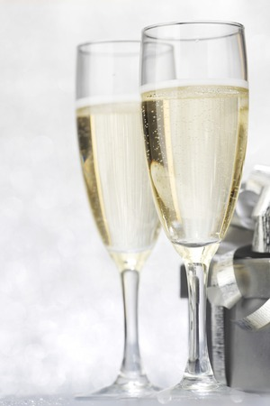 Champagne and present on silver bokeh background photo