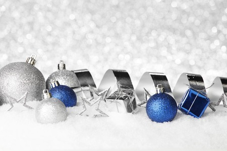Christmas card with decorative baubles on snow photo