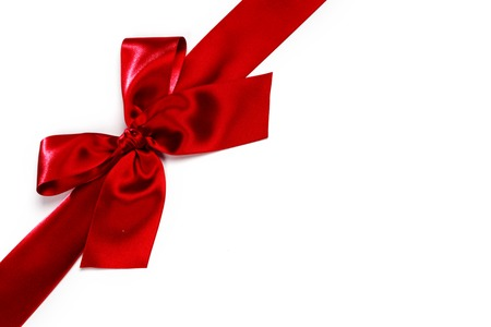 red ribbon bow: Decorative red satin bow isolated on white background