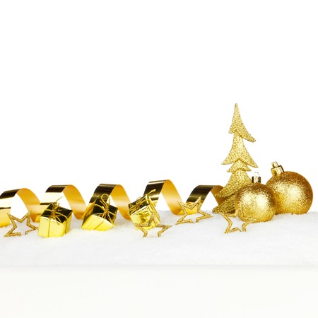 Beautiful various golden christmas decor on snow close-up photo